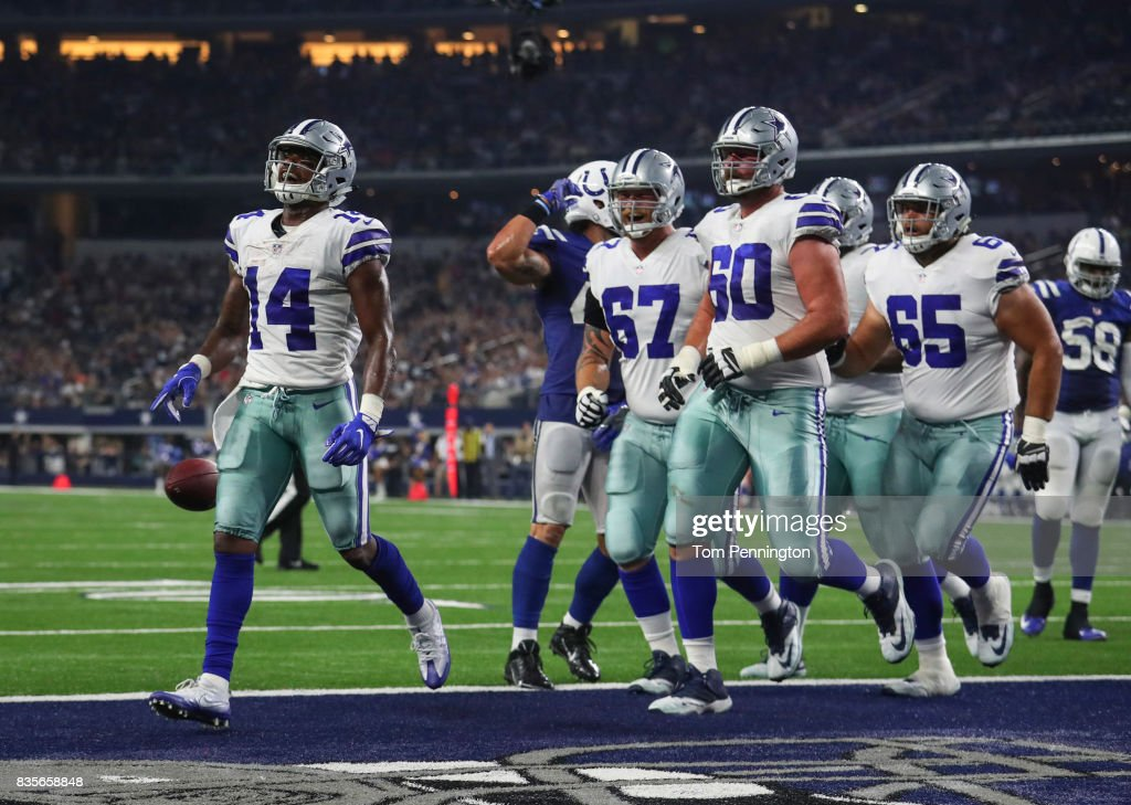 Lance Lenoir #14 of the Dallas Cowboys celebrates a 4th quarter touchdown against the Indianapolis Colts in a preseason game at AT&T Stadium on August 19, 2017 in Arlington, Texas.