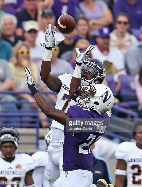 Lance Lenoir of the Western Illinois Leathernecks makes a catch over Matthew Harris of the Northwestern Wildcats on September 20 2014 at Ryan Field...