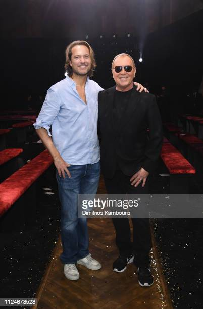 Lance LePere and Michael Kors pose on the runway during Michael Kors Collection Fall 2019 Runway Show at Cipriani Wall Street on February 13 2019 in...