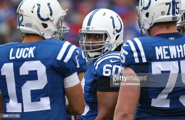 Lance Louis of the Indianapolis Colts looks on between Andrew Luck and Jack Mewhort during NFL game action against the Buffalo Bills at Ralph Wilson...