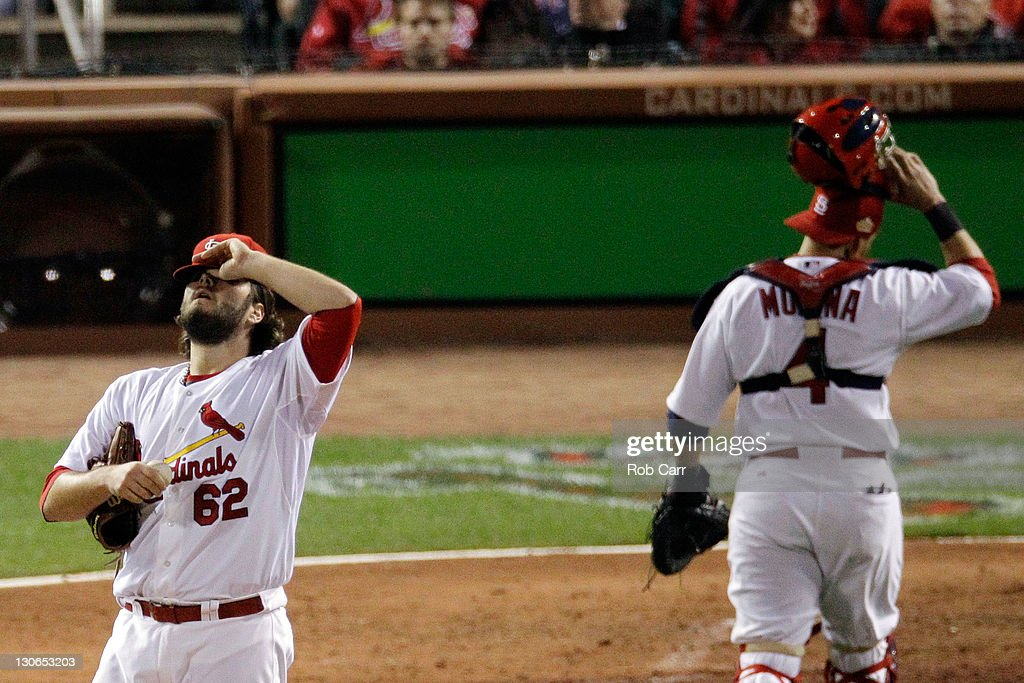 Lance Lynn #62 and Yadier Molina #4 of the St. Louis Cardinals react in the seventh inning during Game Six of the MLB World Series against the Texas Rangers at Busch Stadium on October 27, 2011 in St Louis, Missouri.