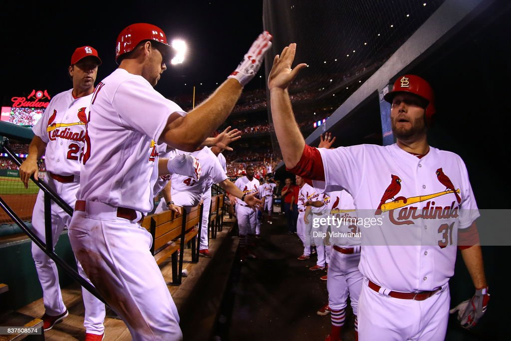 Lance Lynn #31 of the St. Louis Cardinals congratulates Stephen Piscotty #55 of the St. Louis Cardinals after Piscotty hits a home run against the San Diego Padres in the fourth inning at Busch Stadium on August 22, 2017 in St. Louis, Missouri.