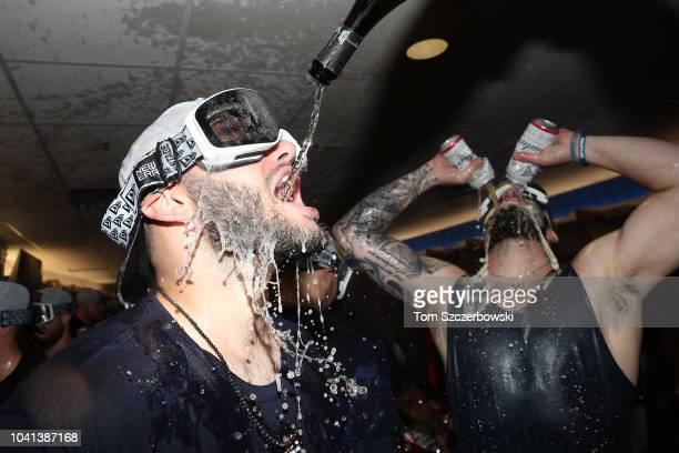 Lance McCullers Jr #43 of the Houston Astros celebrates in the clubhouse with Dallas Keuchel after the Astros clinched the American League West...