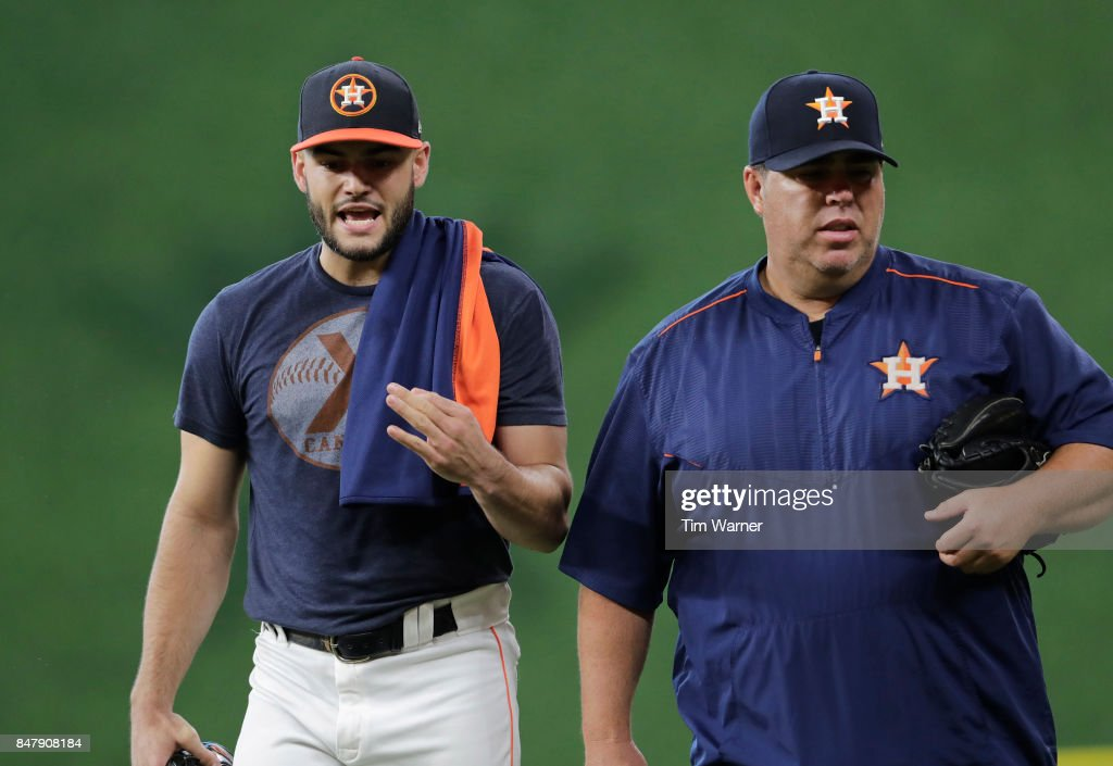 Lance McCullers Jr. #43 of the Houston Astros talks with bullpen coach Craig Bjornson #52 after throwing before the game against the Seattle Mariners at Minute Maid Park on September 16, 2017 in Houston, Texas.