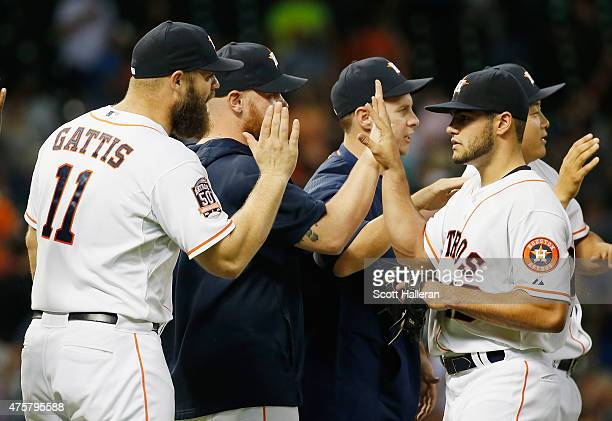 Lance McCullers of the Houston Astros is greeted by Evan Gattis and his teammates after pitching a complete game victory over the Baltimore Orioles...
