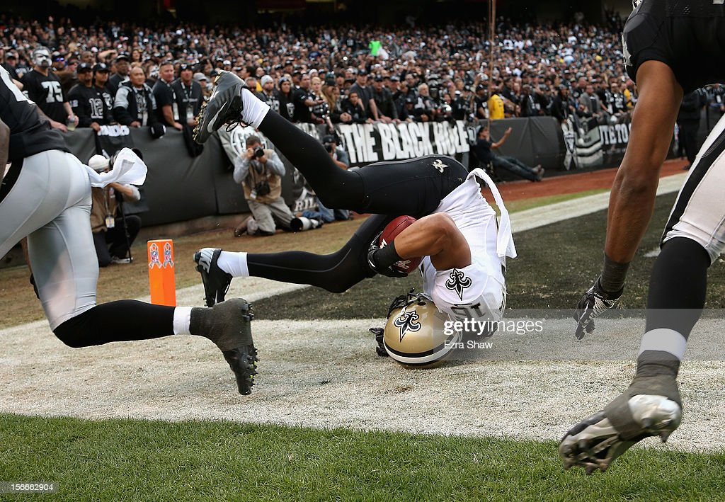 Lance Moore #16 of the New Orleans Saints rolls over after he caught a touchdown during their game the Oakland Raiders at O.co Coliseum on November 18, 2012 in Oakland, California.