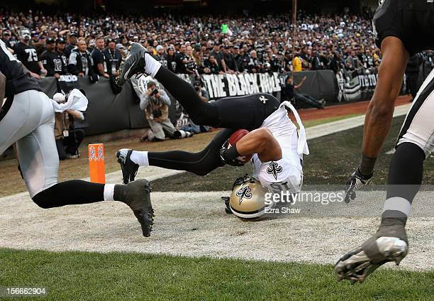 Lance Moore of the New Orleans Saints rolls over after he caught a touchdown during their game the Oakland Raiders at Oco Coliseum on November 18...