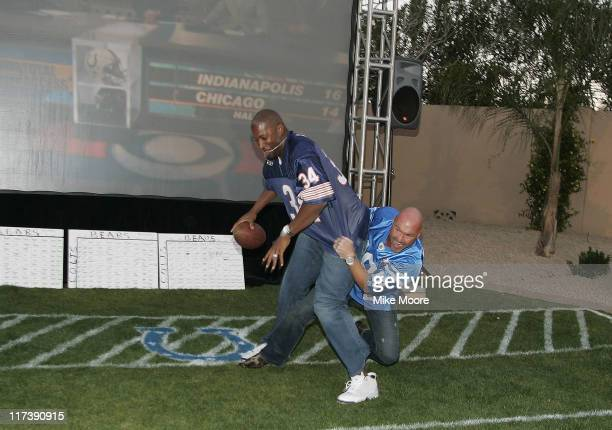 Lance Morris tries to tackle Jermaine Dye during the Morris Foundation's Super Bowl Bash to benefit the Boys and Girls Club of Greater Scottsdale and...