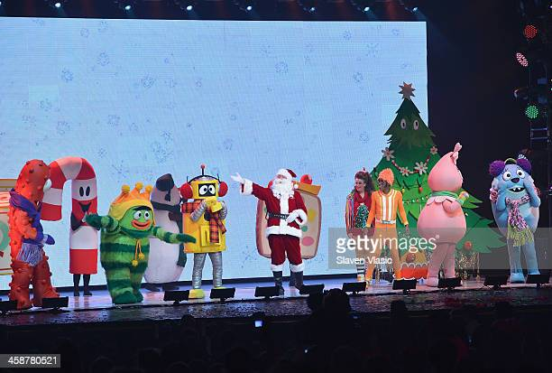 Lance Rock with Muno Foofa Brobee Toodee Plex and Santa Claus perform at Yo Gabba Gabba Live at The Beacon Theatre on December 21 2013 in New York...