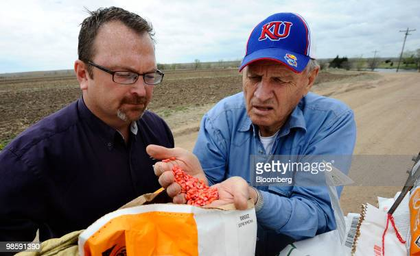 Lance Russell left and his father Harold Kraus check DuPont Co's droughttolerant 'Pioneer' corn seed in preparation for planting on his farm near...