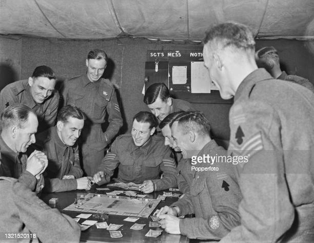 Lance sergeant Philip Batten of the British Army and fellow sergeants play the board game Monopoly in the sergeants mess tent during a training...