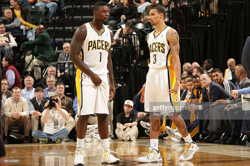 Lance Stephenson #1 and George Hill #3 of the Indiana Pacers have a conference against the Orlando Magic on March 19, 2013 at Bankers Life Fieldhouse in Indianapolis, Indiana.