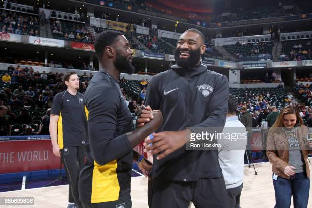 Lance Stephenson of the Indiana Pacers and Kyle O'Quinn of the New York Knicks before the game on December 4 2017 at Bankers Life Fieldhouse in...