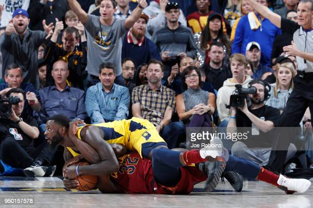 Lance Stephenson of the Indiana Pacers commits a foul while trying to wrestle the ball away from Jeff Green of the Cleveland Cavaliers in the second...