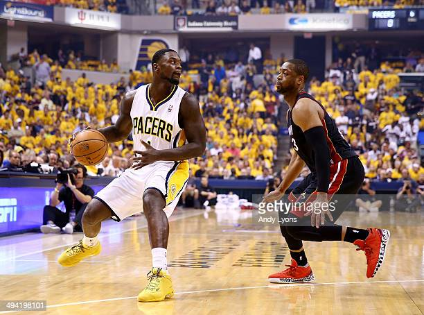 Lance Stephenson of the Indiana Pacers controls the ball as Dwyane Wade of the Miami Heat defends during Game Five of the Eastern Conference Finals...