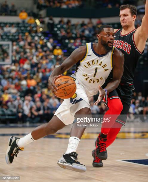 Lance Stephenson of the Indiana Pacers dribbles the ball against Paul Zipser of the Chicago Bulls at Bankers Life Fieldhouse on December 6 2017 in...