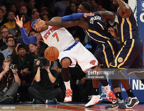 Lance Stephenson of the Indiana Pacers fouls Carmelo Anthony of the New York Knicks in the third quarter at Madison Square Garden on November 20 2013...
