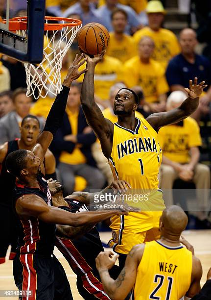 Lance Stephenson of the Indiana Pacers goes to the basket as Chris Bosh of the Miami Heat defends during Game Two of the Eastern Conference Finals of...