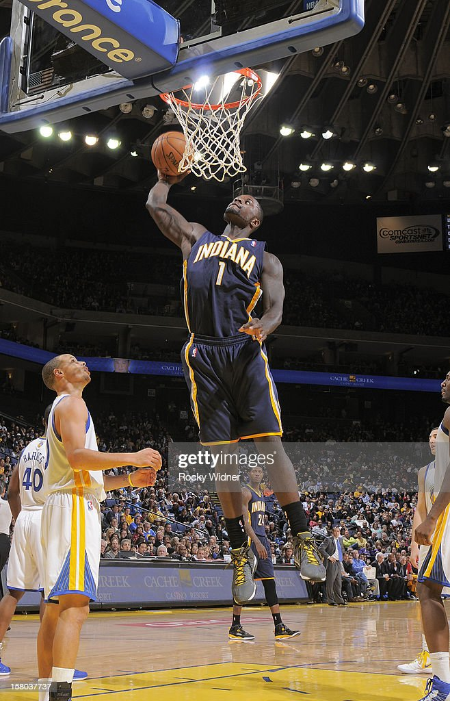 Lance Stephenson #1 of the Indiana Pacers goes up for the dunk against Stephen Curry #30 of the Golden State Warriors on December 1, 2012 at Oracle Arena in Oakland, California.