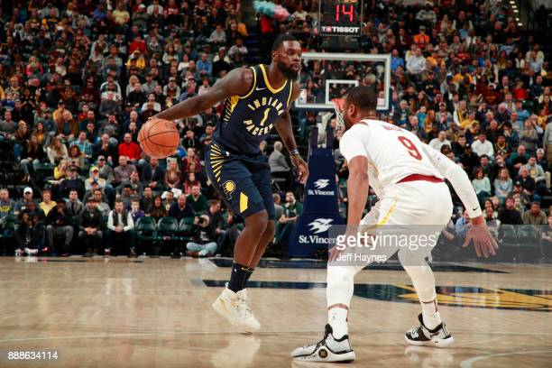 Lance Stephenson of the Indiana Pacers handles the ball against Dwyane Wade of the Cleveland Cavaliers on December 8 2017 at Bankers Life Fieldhouse...