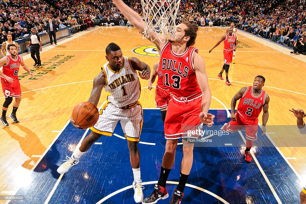 Lance Stephenson #1 of the Indiana Pacers looks to pass the ball in the lane against Joakim Noah #13 of the Chicago Bulls on March 3, 2013 at Bankers Life Fieldhouse in Indianapolis, Indiana.