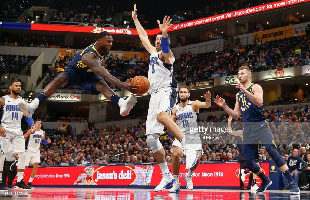 Lance Stephenson #1 of the Indiana Pacers passes the ball off as Nikola Vucevic #9 of the Orlando Magic defends at Bankers Life Fieldhouse on November 27, 2017 in Indianapolis, Indiana.