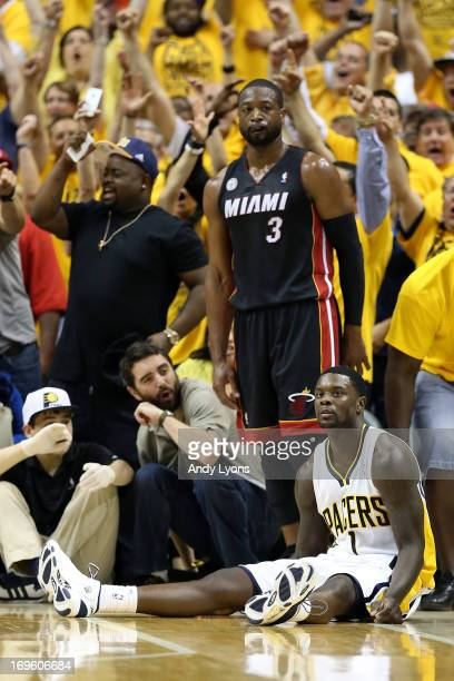 Lance Stephenson of the Indiana Pacers reacts after he made a 3point basket in the second half against Dwyane Wade of the Miami Heat during Game Four...