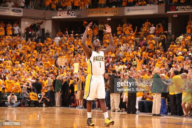 Lance Stephenson of the Indiana Pacers reacts to a crowd support after a win against the New York Knicks in Game Six of the Eastern Conference...