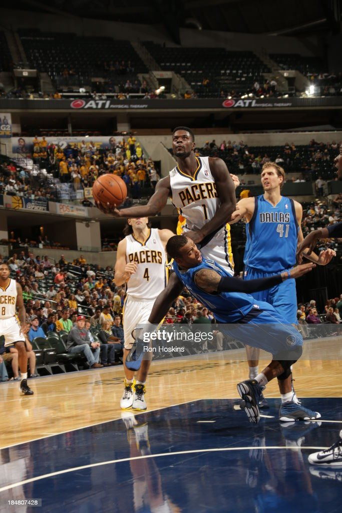 Lance Stephenson #1 of the Indiana Pacers shoots against the Dallas Mavericks at Bankers Life Fieldhouse on October 16, 2013 in Indianapolis, Indiana.
