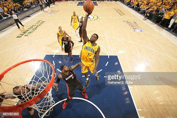 Lance Stephenson of the Indiana Pacers tips in an inbound pass with 01 seconds left in the quarter against LeBron James of the Miami Heat in Game Two...