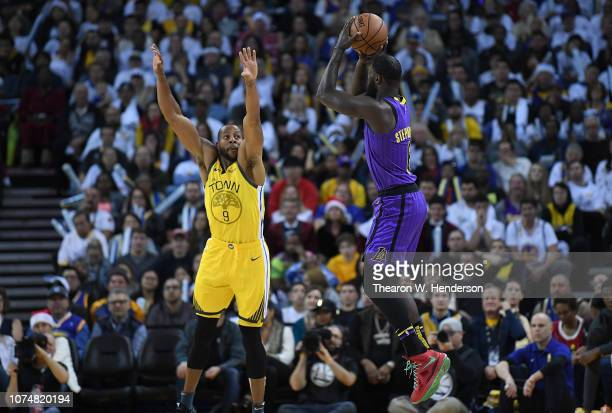 Lance Stephenson of the Los Angeles Lakers shoots a threepoint shot over Andre Iguodala of the Golden State Warriors during the second half of their...