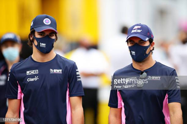 Lance Stroll of Canada and Racing Point and Sergio Perez of Mexico and Racing Point walk in the Paddock during previews ahead of the F1 Grand Prix of...