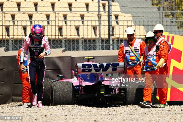 Lance Stroll of Canada and Racing Point walks from his car after crashing during practice for the F1 Grand Prix of Spain at Circuit de...