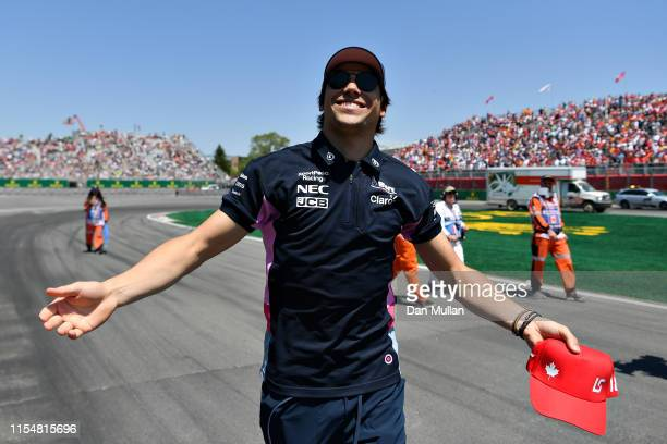 Lance Stroll of Canada and Racing Point waves to the crowd on the drivers parade before the F1 Grand Prix of Canada at Circuit Gilles Villeneuve on...