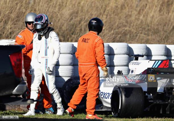 Lance Stroll of Canada and Williams walks from his car after crashing on track during day three of Formula One winter testing at Circuit de Catalunya...
