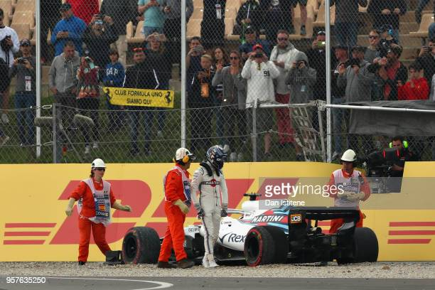 Lance Stroll of Canada and Williams walks from his car after crashing during qualifying for the Spanish Formula One Grand Prix at Circuit de...
