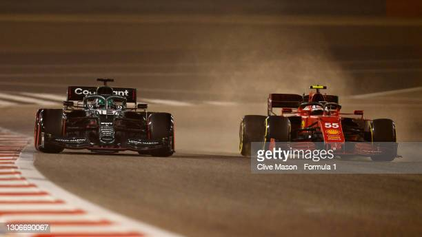 Lance Stroll of Canada driving the Aston Martin AMR21 Mercedes battles with Carlos Sainz of Spain driving the Scuderia Ferrari SF21 on track during...