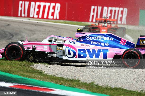 Lance Stroll of Canada driving the Racing Point RP19 Mercedes spins with Sebastian Vettel of Germany driving the Scuderia Ferrari SF90 behind during...