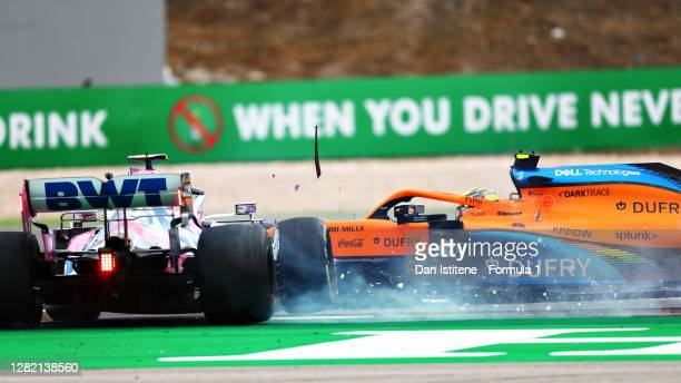 Lance Stroll of Canada driving the Racing Point RP20 Mercedes and Lando Norris of Great Britain driving the McLaren F1 Team MCL35 Renault crash...