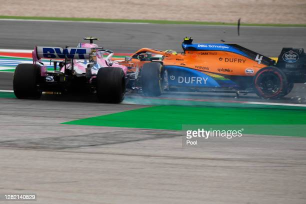 Lance Stroll of Canada driving the Racing Point RP20 Mercedes clashes with Lando Norris of Great Britain driving the McLaren F1 Team MCL35 Renault...