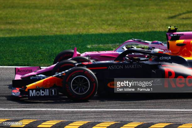 Lance Stroll of Canada driving the Racing Point RP20 Mercedes overtakes Max Verstappen of the Netherlands driving the Aston Martin Red Bull Racing...