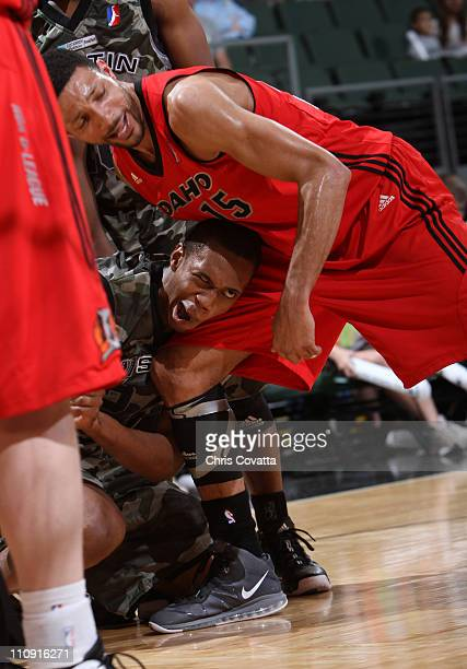 Lance Thomas of the Austin Toros suffers a seizure as Tony Bobbitt of the Idaho Stampede holds him during their game on March 26 2011 at the Cedar...
