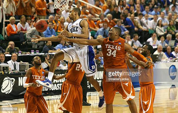 Lance Thomas of the Duke Blue Devils battles for a rebound against Dexter Pittman of the Texas Longhorns during the second round of the NCAA Division...