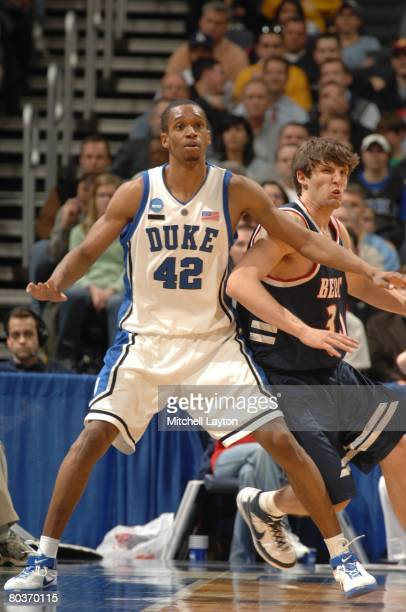 Lance Thomas of the Duke Blue Devils posts up under basket during a NCAA Men's Basketball first round game against the Belmont Bruins at Verizon...