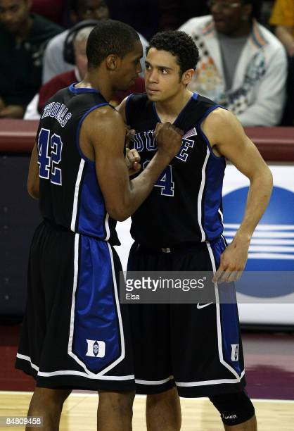 Lance Thomas of the Duke Blue Devils talks with his replacement David McClure after Thomas fouled out of the game the Boston College Eagles on...