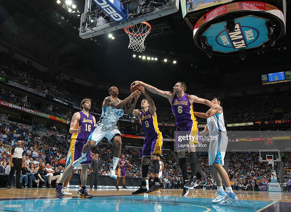 Lance Thomas #42 of the New Orleans Hornets battles for the ball with Matt Barnes #9 and Josh McRoberts #6 of the Los Angeles Lakers on April 9, 2012 at the New Orleans Arena in New Orleans, Louisiana.