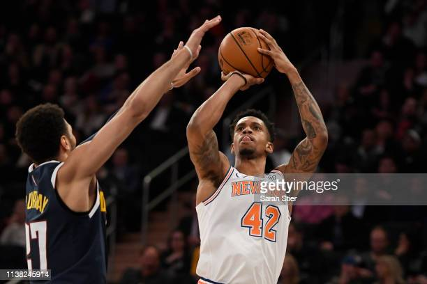 Lance Thomas of the New York Knicks attempts a basket during the second half of the game against the Denver Nuggets at Madison Square Garden on March...