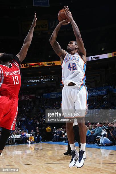 Lance Thomas of the Oklahoma City Thunder takes a shot against the Houston Rockets on November 16 2014 in Oklahoma City Oklahoma NOTE TO USER User...