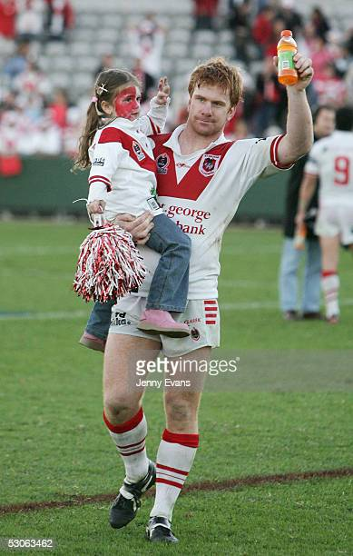 Lance Thompson and daughter Shalisse salute the crowd after the Dragons won against the Cowboys during round 14 NRL match between the St George...