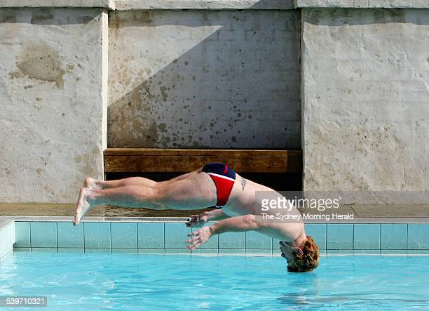 Lance Thompson of the St George Illawarra Dragons dives into a pool at North Cronulla as part of the Dragons' recovery session 15 August 2005 SMH...